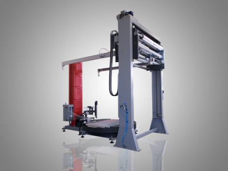 Masina pentru infoliat cu masa rotativa si alimentator pentru folie capac